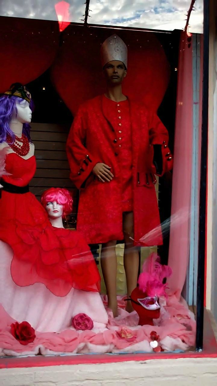 king of the costume shoppe window